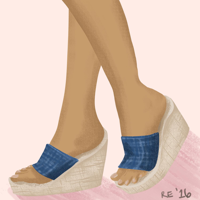 Feet with denim wedge sandals